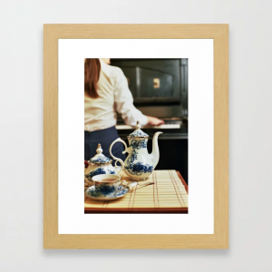 Tea pot and girl playing the piano Framed Art Print